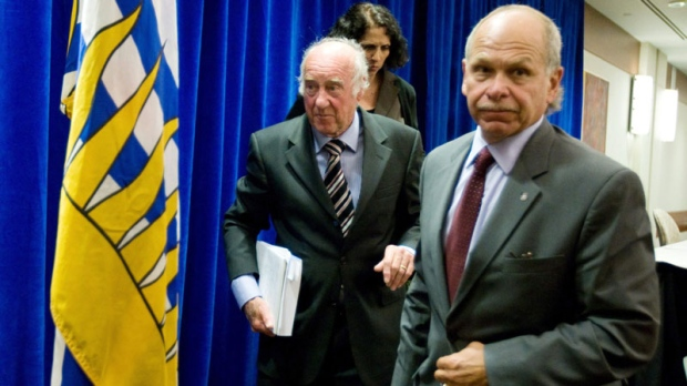 Retired judge Thomas Braidwood, left, and Braidwood Commission counsel Art Vertlieb leave following a news conference regarding phase one of his inquiry into the use of tasers by police in British Columbia, in Vancouver, B.C., on Thursday July 23, 2009. (THE CANADIAN PRESS/Darryl Dyck)