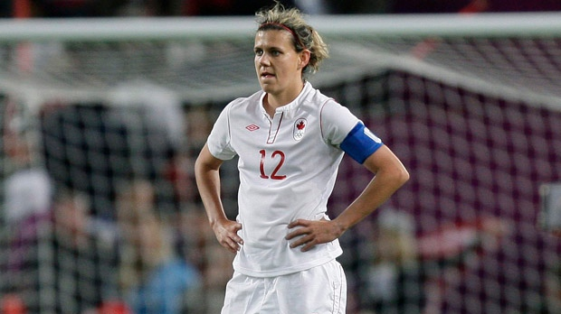 Canada's Christine Sinclair reacts after her team's 4-3 loss to the United States in their semifinal women's soccer match at the 2012 London Summer Olympics on Monday, Aug. 6, 2012, at Old Trafford Stadium in Manchester, England. (AP Photo/Jon Super)