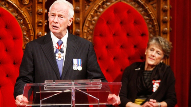 Governor General David Johnston addresses the audience after being installed as Canada's 28th Governor General next to his wife Sharon during a ceremony in the Senate on Parliament Hill, Friday, Oct. 1, 2010. (Adrian Wyld / THE CANADIAN PRESS)