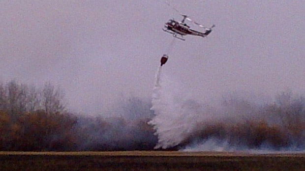 A water bomber is used to battle the wildfires in southeastern Manitoba on Oct. 3, 2012.
