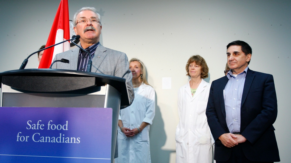 Agriculture Minister Gerry Ritz, left, and Canadian Food Inspection Agency (CFIA) President George Da Pont, right, speak to media to provide an update on Canadian food safety in Calgary, Alta., on Wednesday, Oct. 3, 2012. (Jeff McIntosh / THE CANADIAN PRESS)