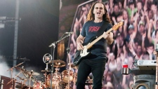 Geddy Lee of Rush, the mythic Canadian rock group performs in front of a crowd of close to 100,000 f