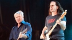 Alex Lifeson, left, and Geddy Lee of Rush perform in front of a crowd of close to 100,000 fans as part of the Quebec Summer Festival in Quebec City on Thursday, July 15, 2010. (The Canadian Press/Jacques Boissinot Rush)