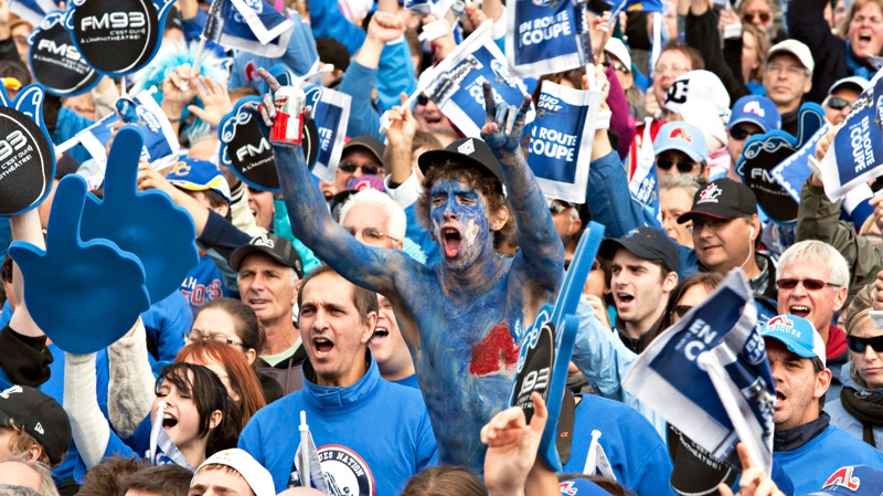 """Over 60,000 people, mostly dressed in blue, gather on the Plains of Abraham in a gathering called """"La Marche Bleue"""" asking for a comeback of an NHL team in the city and a new arena in Quebec City, Saturday, October 2, 2010. (Jacques Boissinot / THE CANADIAN PRESS)"""