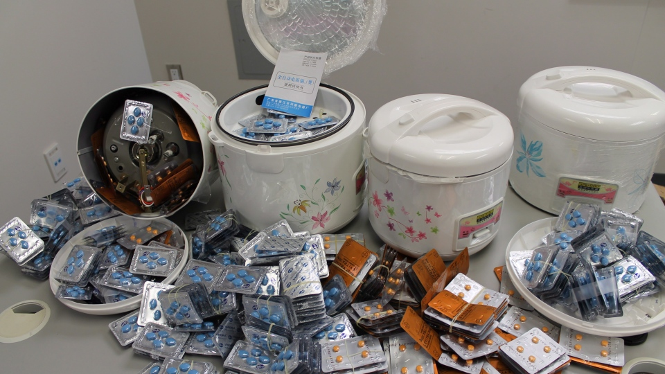 Police say in a news release that Canada Border Services Agency officials found about 2,400 fake Viagra and Levitra pills in electric rice cookers being shipped into Canada from China. (RCMP / THE CANADIAN PRESS)
