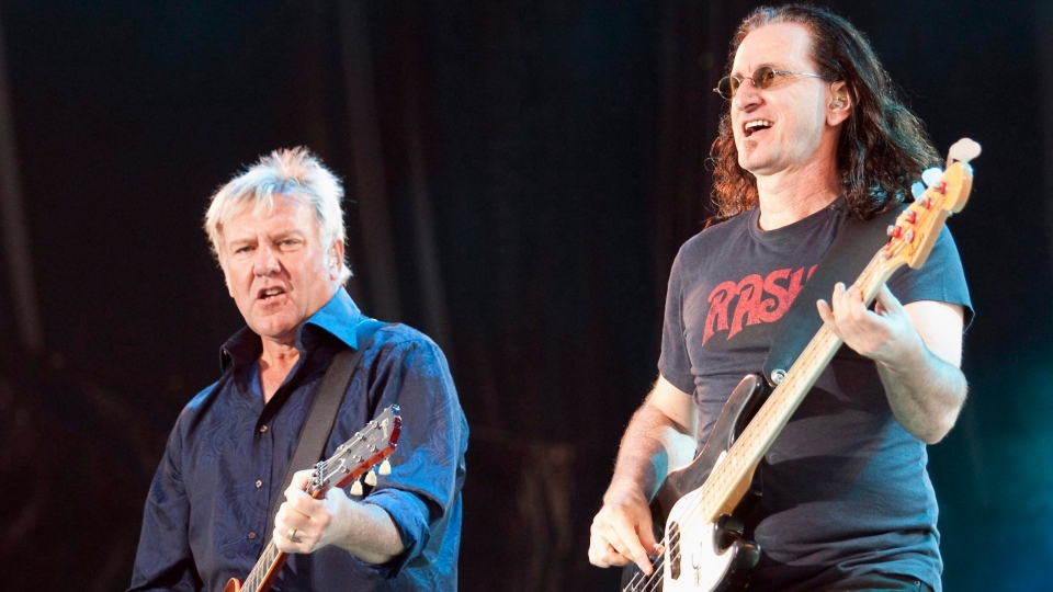 Alex Lifeson, left, and Geddy Lee of Rush, the mythic Canadian rock group, perform in front of a crowd of close to 100,000 fans as part of the Quebec Summer Festival in Quebec City, Thursday, July 15, 2010. (Jacques Boissinot / THE CANADIAN PRESS)