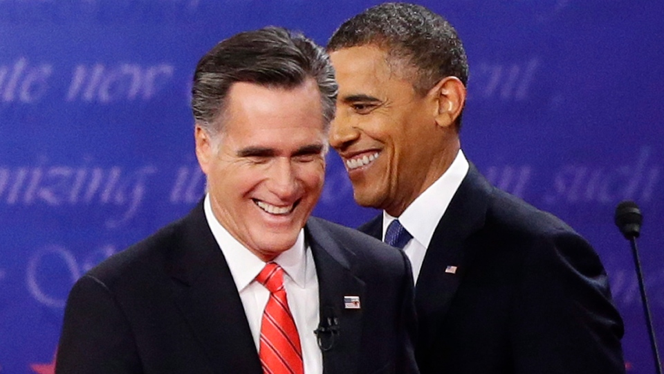 U.S. President Barack Obama and Republican presidential candidate and former Massachusetts Gov. Mitt Romney talk at the end of the first presidential debate in Denver, Wednesday, Oct. 3, 2012. (AP / Charles Dharapak)