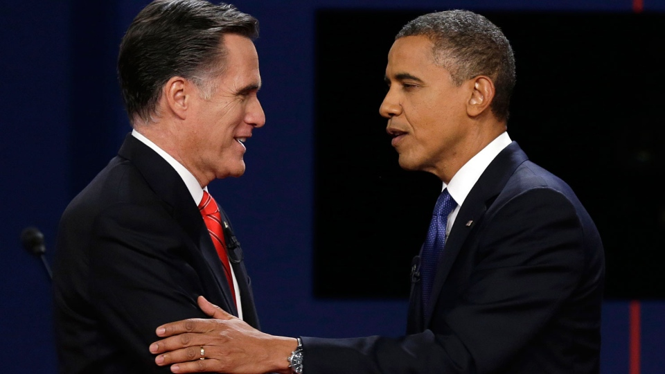 Republican presidential nominee Mitt Romney and President Barack Obama shake hands after the first presidential debate at the University of Denver, in Denver on Oct. 3, 2012. (AP / Charlie Neibergall)