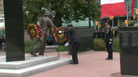 A wreath is placed next to the Ontario Fire Fighter Memorial at Queen's Park on Sunday, Oct. 3, 2010.