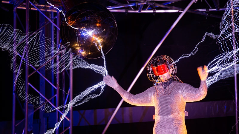 "Magician David Blaine stands inside an apparatus surrounded by a million volts of electric currents streamed by tesla coils during his 72-hour ""Electrified: 1 Million Volts Always On"" stunt on Pier 54, Friday, Oct. 5, 2012, in New York. (AP / John Minchillo)"