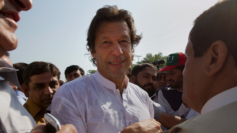 "Pakistan's ex-cricket star-turned-politician Imran Khan, centre, is surrounded by his supporters as he arrives to lead what organizers are calling the ""peace march,"" in Islamabad, Pakistan, Saturday, Oct. 6, 2012. (AP)"