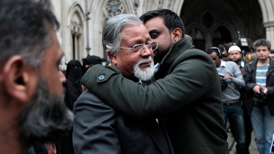 Syed Abu Ahsan, father of Syed Talha Ahsan, centre left, is consoled by a supporter as he leaves the Royal Courts of Justice in London after hearing his son's appeal against extradition to the United States on terror charges had failed, Friday, Oct. 5, 2012. (AP / Sang Tan)