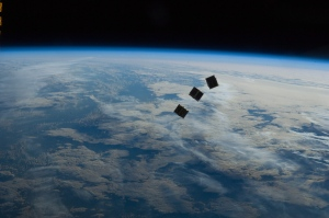 This image provided by NASA shows several tiny satellites shortly after launch photographed by an Expedition 33 crew member on the International Space Station. (AP / NASA)