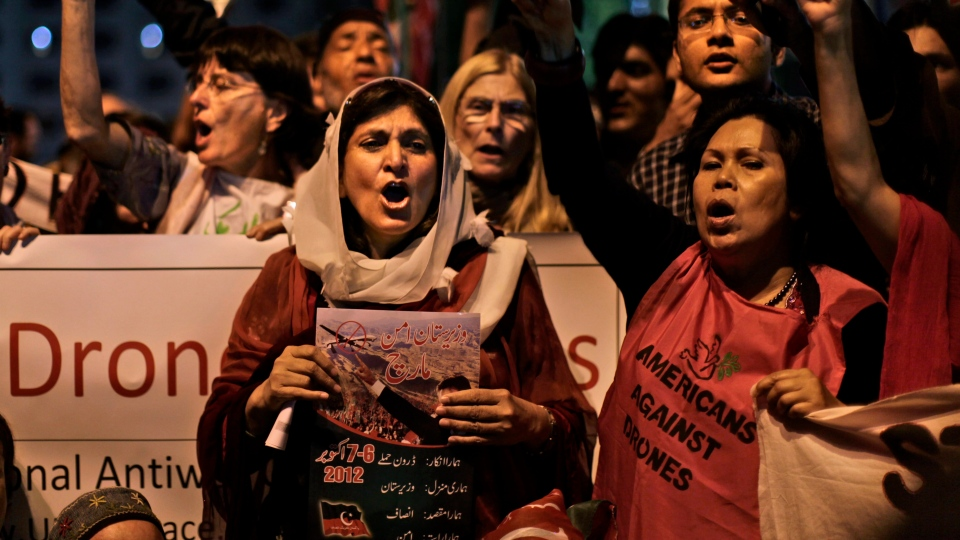 Pakistanis and American citizens hold banners and chant slogans against drone attacks in Pakistani tribal belt, in Islamabad, Pakistan, Friday, Oct. 5, 2012. (AP / Muhammed Muheisen)