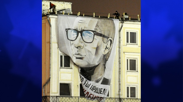 "A giant Russian President Vladimir Putin billboard reading ""Good that you came. Happy Birthday"" set up by a group of an unknown movement on a building, which faces the Kremlin , is seen in downtown Moscow early Sunday, Oct. 7, 2012. (AP Photo/Ridus.ru, Anton Belitsky)"