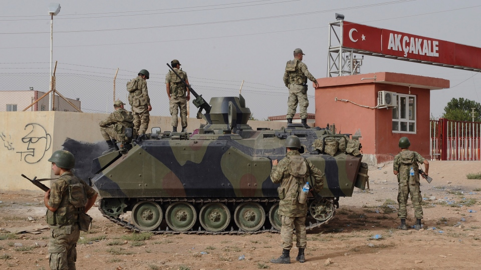 Turkish military station at the border gate with Syria, across from Syrian rebel-controlled Tel Abyad town, in Akcakale, Turkey on Sunday, Oct. 7, 2012. (AP Photo)