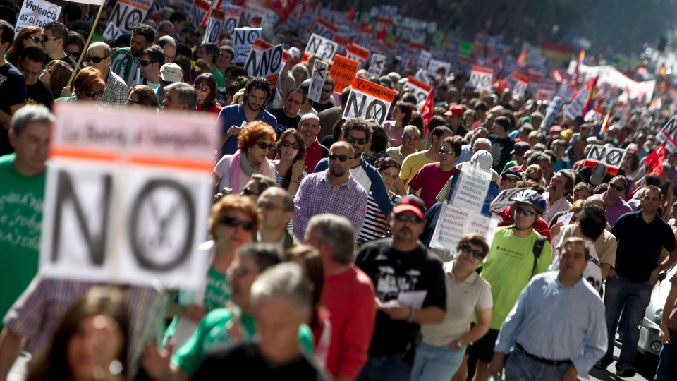 People hold banners against cuts during a demonstration in Madrid, Spain on Sunday, Oct. 7, 2012.  (AP /Alberto Di Lolli)
