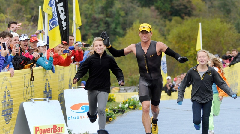 Lance Armstrong competes in triathlon.