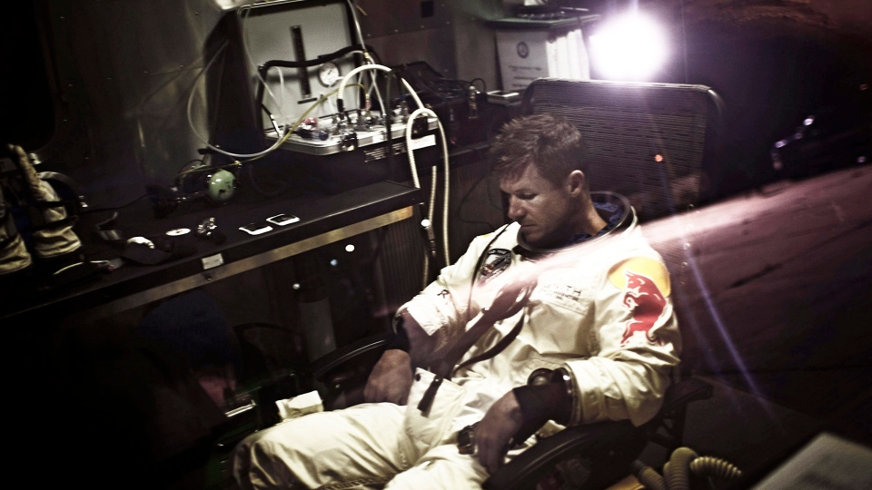 In a photo provided by Red Bull, pilot Felix Baumgartner of Austria, sits in his trailer during the preparations for the final manned flight of the Red Bull Stratos mission in Roswell, N.M. on Saturday, Oct. 6, 2012. (AP / Red Bull, Joerg Mitter)