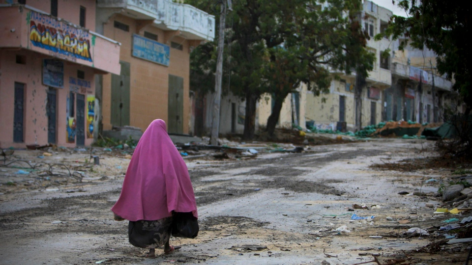 A woman walks through the deserted streets of Bakara Market in central Mogadishu in this photo released by the African Union-United Nations Information Support Team on Tuesday Aug. 9, 2011. (AP / AU-UN IST/ Stuart Price)