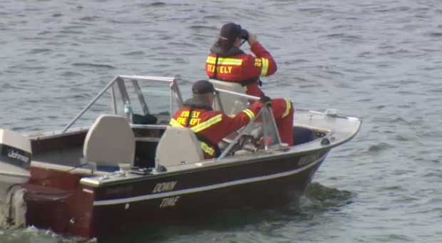 A rescue boat from Stavely scours the surface of the Pine Coulee reservoir, searching for a man presumed drowned over the weekend.