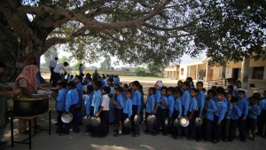 Indian schoolchildren line up for a free midday meal, provided on all working days at a government school on the outskirts of Jammu, India, Tuesday, Oct. 9. (AP / Channi Anand)