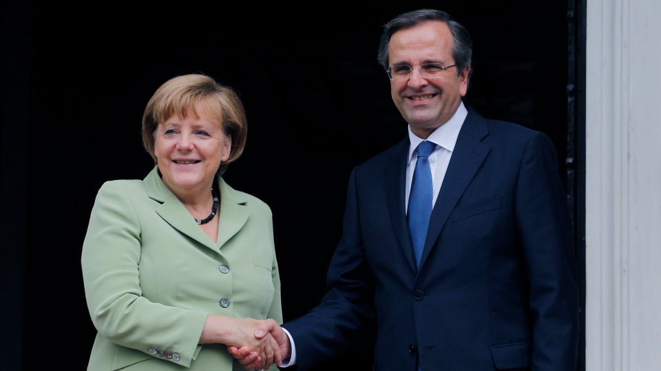 Greece's Prime Minister Antonis Samaras, right, and Germany's Chancellor Angela Merkel shake hands at the Maximos mansion in Athens, Tuesday, Oct. 9, 2012. (AP / Petros Giannakouris)