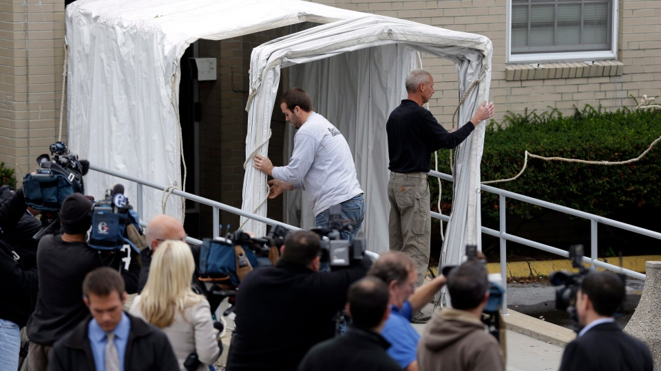 A privacy tunnel is erected at the Centre County Courthouse Monday, Oct. 8, 2012, in Bellefonte, Pa. (AP / Matt Rourke)