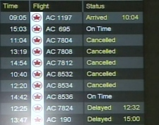 A monitor at Toronto's Pearson International Airport shows many flight delays and cancellations due to the storm on Wednesday, Feb.6, 2008.