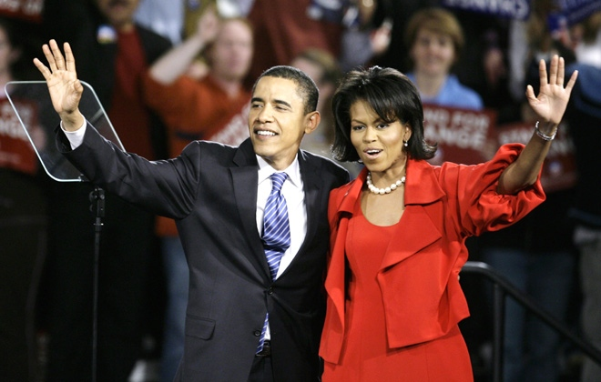 Democratic presidential hopeful Sen. Barack Obama D-Ill., and his wife Michelle wave to supporters at a Super Tuesday primary rally in Chicago, Ill., on Tuesday, Feb. 5, 2008. (AP / M. Spencer Green)