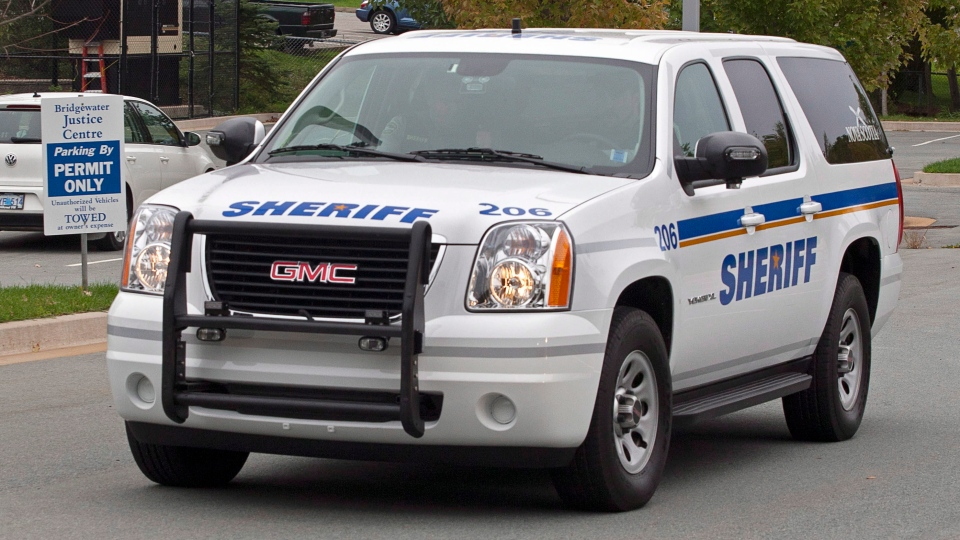 A sheriff's vehicle transports David James Leblanc, facing charges of sexually assaulting and confining a teenage boy, from provincial court in Bridgewater, N.S. on Tuesday, Oct. 9, 2012. (Andrew Vaughan / THE CANADIAN PRESS)