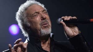 In this Sept. 24, 2009 file photo, singer Tom Jones performs at the Guinness 250th Anniversary Celebration at the Guinness storehouse in Dublin, Ireland. (AP Photo/Joel Ryan)