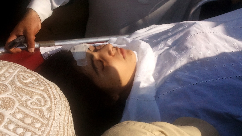 A wounded Pakistani girl, Malala Yousufzai, is moved to a helicopter to be taken to Peshawar for treatment in Mingora, Swat Valley, Pakistan on Tuesday, Oct. 9, 2012.  (AP/Sherin Zada)