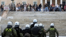 Protesters throw stones Athens Oct. 9, 2012