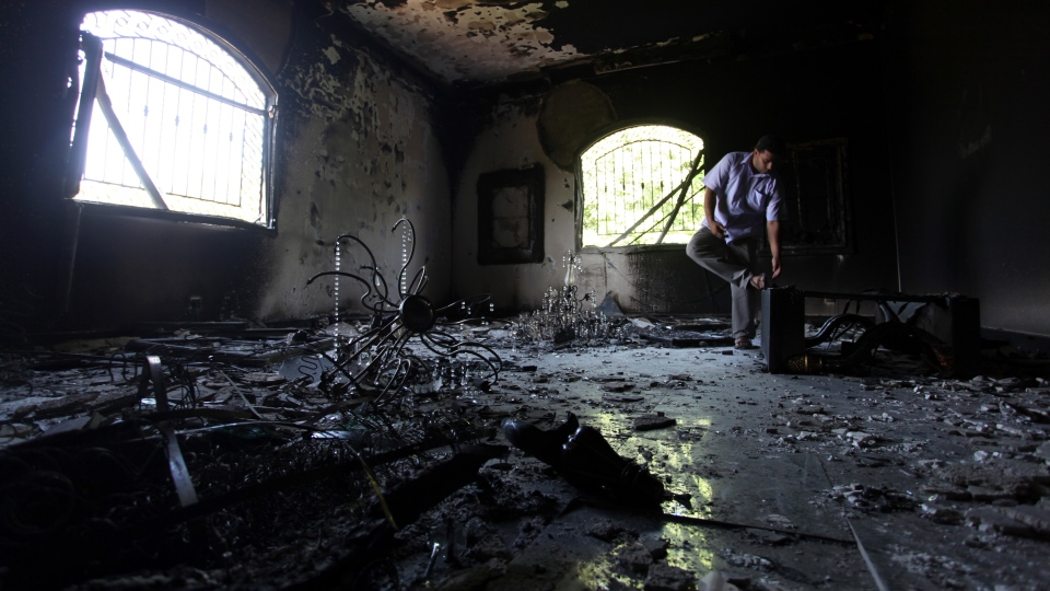 A Libyan man investigates the inside of the U.S. Consulate, after an attack that killed four Americans, including Ambassador Chris Stevens on the night of Tuesday, Sept. 11, 2012, in Benghazi, Libya,  Sept. 13, 2012. (AP / Mohammad Hannon)