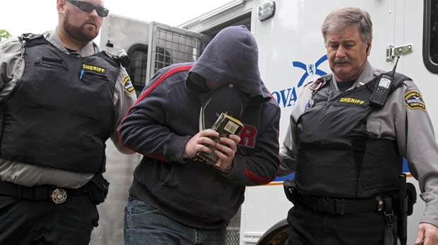 Jeffrey Delisle is escorted into Nova Scotia provincial court in Halifax on Wednesday, June 13, 2012. (Mike Dembeck / THE CANADIAN PRESS)