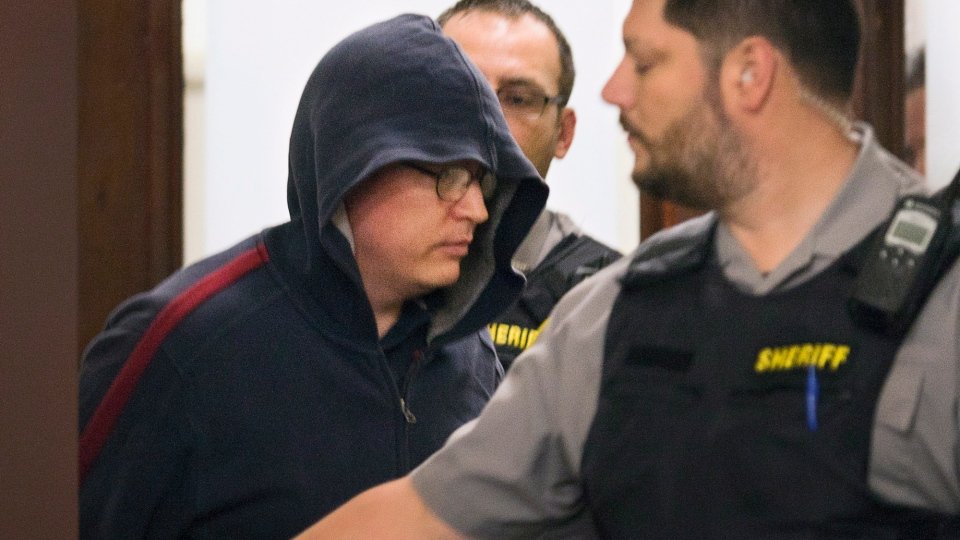 Sub.-Lt. Jeffrey Paul Delisle leaves provincial court after pleading guilty to charges related to communicating information to a foreign entity, before his preliminary hearing in Halifax on Wednesday, Oct. 10, 2012. (Andrew Vaughan / CANADIAN PRESS)