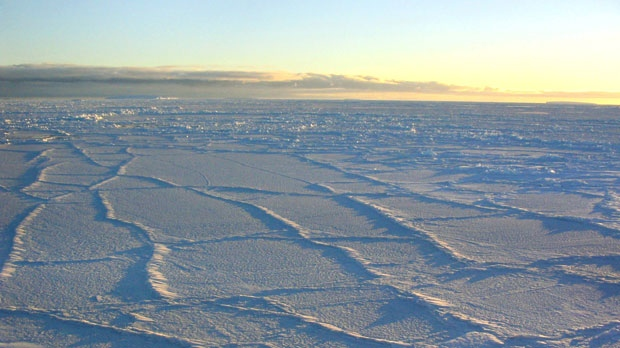 The Antarctic sunlight illuminates the surface of the sea ice, intensifying the effect of the fracture lines, Oct. 2003. (NSIDC, University of Colorado)