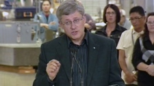 Prime Minister Stephen Harper answers reporters questions after a press conference at the Bristol Aerospace plant in Winnipeg on Thursday, Oct. 7, 2010.