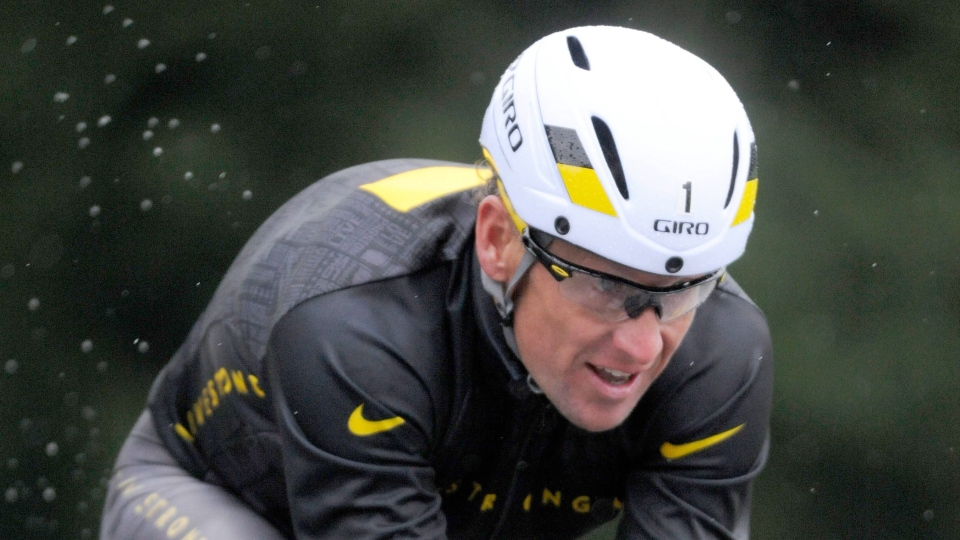 Lance Armstrong competes in the Rev3 Half Full Triathalon in Ellicott City, Md., on Sunday, Oct. 7, 2012. (AP /Steve Ruark)