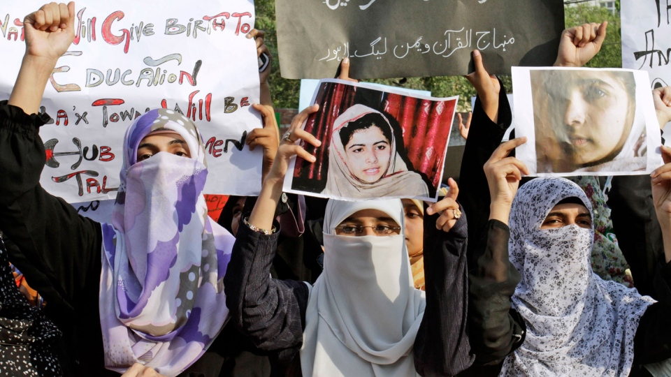 Pakistani members of Minhaj-ul-Quran Women League, hold up pictures of 14-year-old schoolgirl Malala Yousufzai, who was shot on Tuesday by the Taliban for speaking out in support of education for women, during a protest to condemn the attack, in Lahore, Pakistan, Wednesday, Oct. 10, 2012. (AP / K.M. Chaudary)