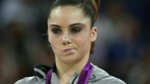 Gymnast facial reaction after winning Silver at the Olympics.