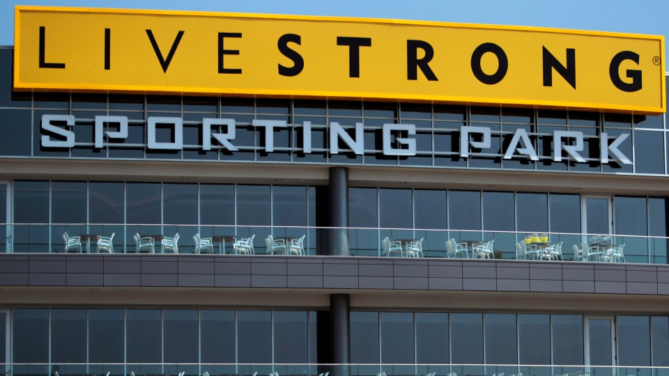 Signs and balconies overlook the main entrance of Livestrong Sporting Park, home of the Sporting Kansas City MLS soccer club, in Kansas City, Kan., June 7, 2011. (AP / Orlin Wagner)