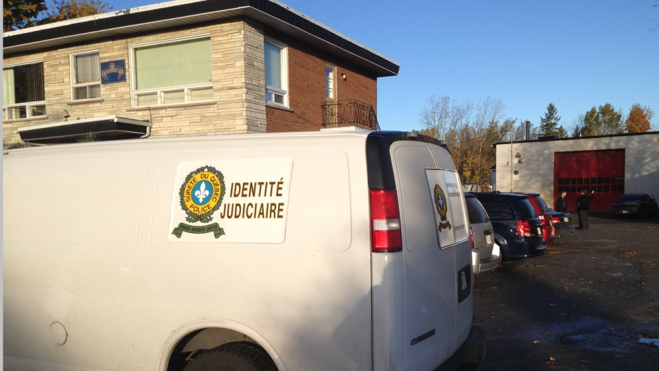 A Surete du Quebec van is parked outside of Poly Excavation in Laval while UPAC officers search the premises (Oct. 11, 2012, CTV Montreal/Jean-Luc Boulch)