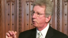 Veterans Affairs Minister Jean-Pierre Blackburn speaks to reporters in Ottawa on Thursday, Oct. 7, 2010.