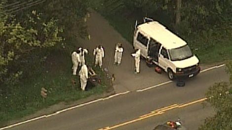 Police in Surrey, B.C., investigate a body discovered on a lawn on Oct. 7, 2010. (CTV)