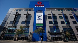 A cyclist rides past Rogers Arena, the home of the Vancouver Canucks NHL hockey team, in Vancouver, B.C., on Sunday September 16, 2012. (Darryl Dyck/ THE CANADIAN PRESS)