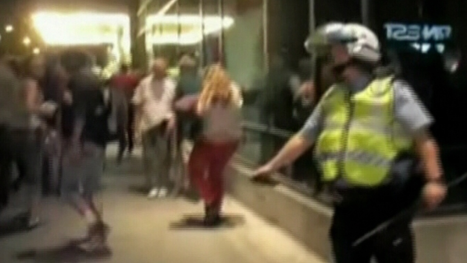 Const. Stefanie Trudeau, known locally as 'No. 728' after her badge number is seen pepper-spraying protesters in Montreal last year.