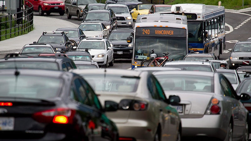 Motorists merge from four lanes into one as they enter the Lions Gate Bridge to drive into Vancouver, B.C., on Friday July 15, 2011. (Darryl Dyck / THE CANADIAN PRESS)