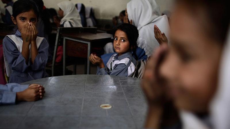 Pakistani girls pray